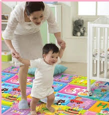 Baby Learning To Walk On Safety Mat