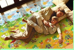 Mom and Son Laying on Safety Mat
